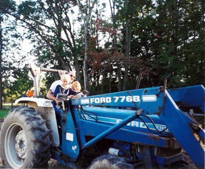 Mark Faille with his children, Stacie and Dylan during the early days of the farm in NJ