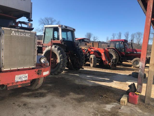 Working on farm equipment maintenance